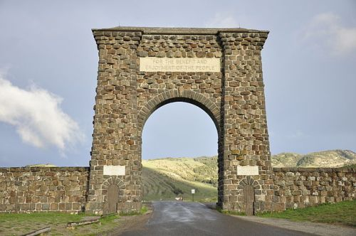"A stone arch at the north entrance to Yellowstone National Park.  A stone tablet on the arch reads ""For the benefit and enjoyment of the people."""