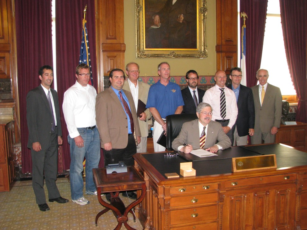 Governor Branstad signs legislation authorizing new solar tax credits as supporters look on