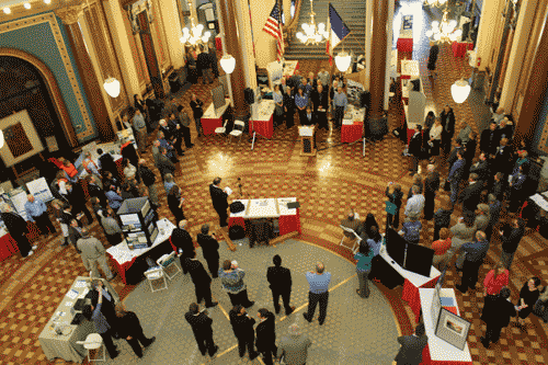 Participants gather in the statehouse rotunda for a press conference.