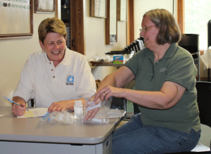 Linda Kinman (left) the Council's past president, reviews water samples taken by volunteers with Susan Heathcote, the Council's water program director.