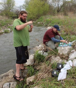 Nevin Cornwell (left) and Craig Dilley complete water tests on Four Mile Creek on the north side of Ankeny.
