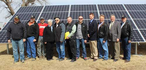 Tour participants gather in front of a 17 kW array at Paul Reed's farm in Washington County.  From left to right: Ken Reed, Paul Reed, Unidentified, Rep. Sally Stutsman, Rep. Dave Maxwell, Rep. Curtis Hanson, Tim Dwight, iPower, Rep. Jarad Klein,  Denny Harding, Iowa Farm Bureau, Sec. of Agriculture Bill Northey, and Sen. Ken Rozenboom